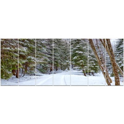 Snowy Road In The Forest Landscape Canvas Art Print - 7 Panels