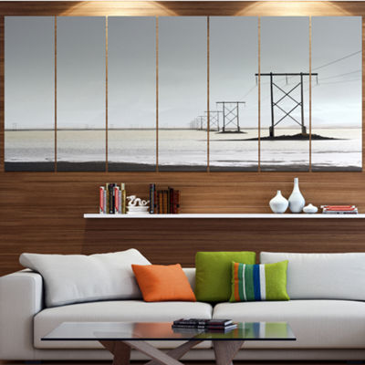 Designart Electricity Pylons Over Lagoon LandscapeLarge Canvas Art Print - 5 Panels