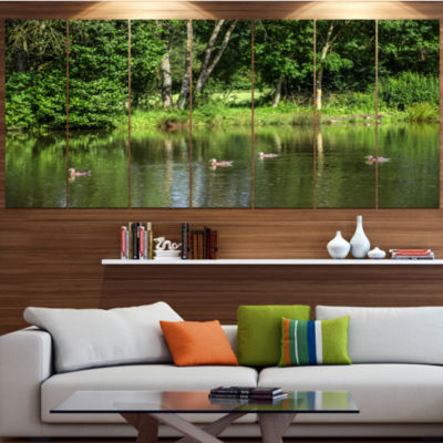 Designart Bushes And Trees In River Bank LandscapeCanvas Art Print - 4 Panels