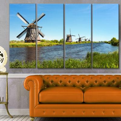 Designart Windmills At Kinderdijk Landscape CanvasArt Print- 4 Panels