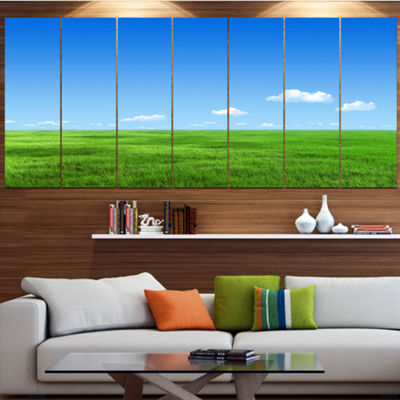 Designart Green Meadow And Blue Sky Landscape Canvas Art Print - 7 Panels