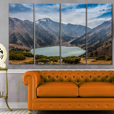 Designart Mountain Lake Under Blue Sky LandscapeCanvas Art Print - 4 Panels