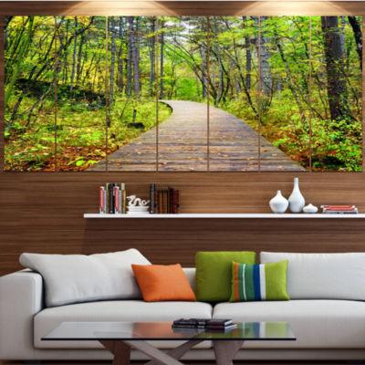 Designart Wooden Boardwalk Across Forest LandscapeCanvas Art Print - 4 Panels