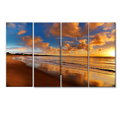 Designart Colorful Sunset On The Beach LandscapeCanvas Art Print - 4 Panels