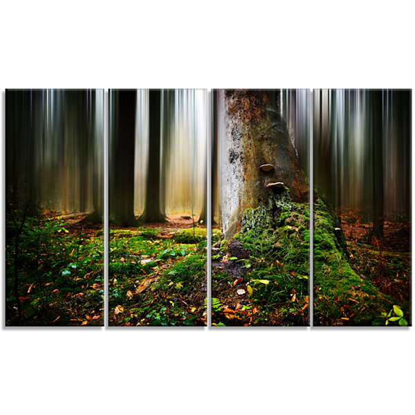 Designart Green Forest On Snowy Morning LandscapeCanvas Art Print - 4 Panels