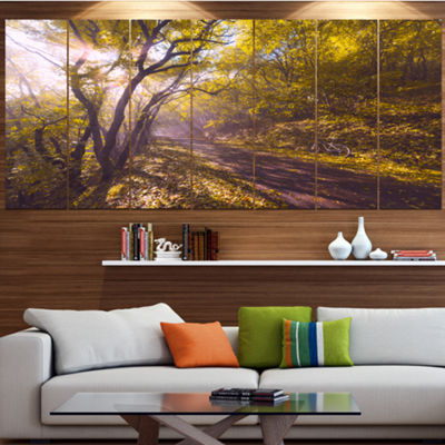 Designart Bicycle Ride In Fall Forest Landscape Canvas Art Print - 4 Panels