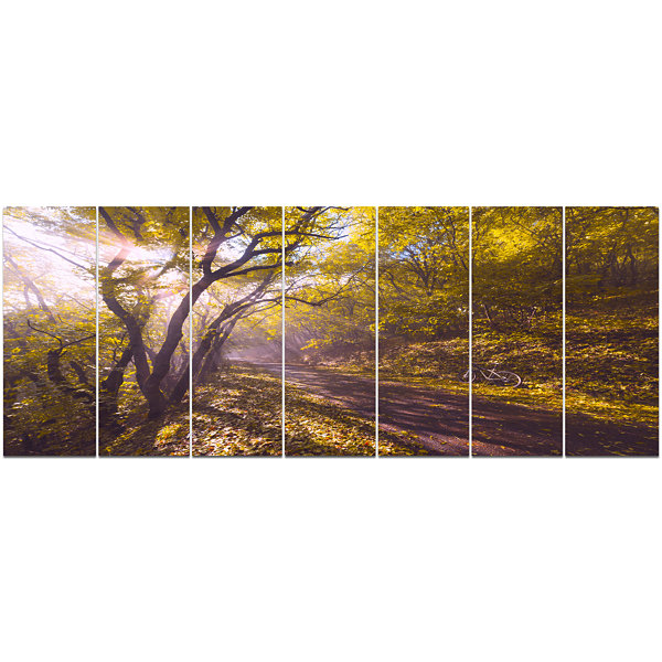 Designart Bicycle Ride In Fall Forest Landscape Canvas Art Print - 7 Panels