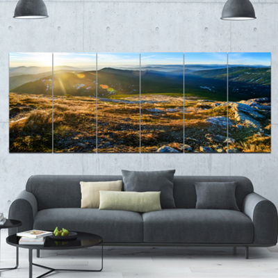 Designart Mountains Glowing In Sunlight LandscapeCanvas Art Print - 6 Panels