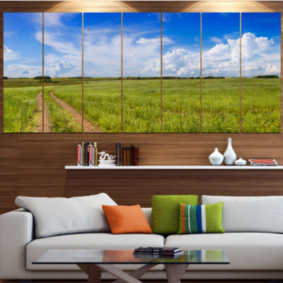 Road In Field With Green Grass Landscape Canvas Art Print - 4 Panels