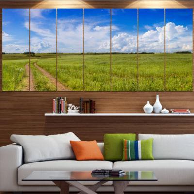 Designart Road In Field With Green Grass LandscapeCanvas Art Print - 4 Panels