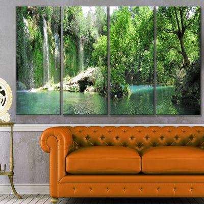 Designart Waterfall Cascade In Deep Forest Landscape Canvas Art Print - 4 Panels