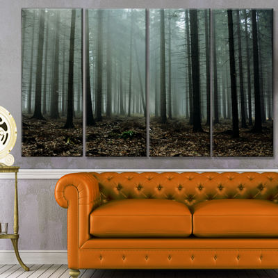 Designart Gloomy Sunrays In Dark Forest LandscapeCanvas Art Print - 4 Panels