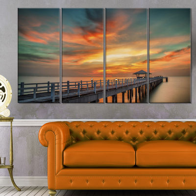 Designart Colorful Sky And Long Wooden Pier PierCanvas Art Print - 4 Panels