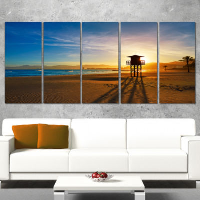 Designart Colorful Sunset In Valencia Modern BeachWrapped Canvas Art Print - 5 Panels