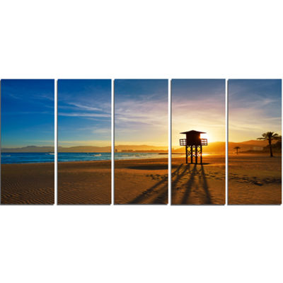 Designart Colorful Sunset In Valencia Modern BeachCanvas Art Print - 5 Panels