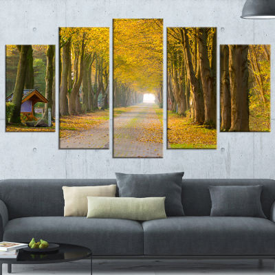 Designart Country Road Below Yellow Trees Landscape Photography Canvas Print - 4 Panels