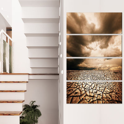 Designart Cracked Drought Land With Dark Clouds Oversized Landscape Canvas Art - 4 Panels