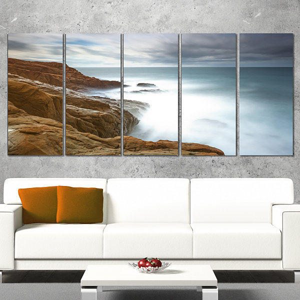 Designart Dark Red Rocks And Foam Waves SeascapeWrapped Canvas Art Print - 5 Panels