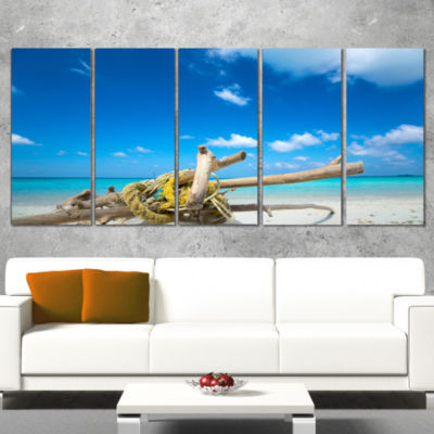 Designart Deadwood On White Sand Beach Seashore Wrapped Canvas Art Print - 5 Panels