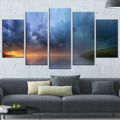 Designart Dense Blue Clouds Over Lake Skyline Photography Wrapped Canvas Art - 5 Panels