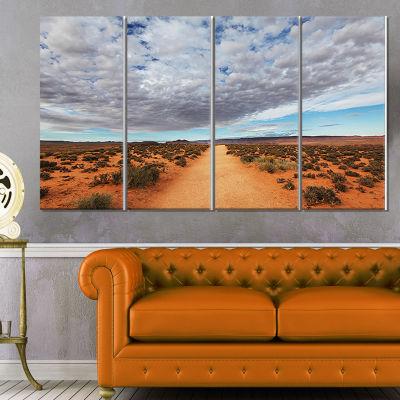 Design Art Desert Road Under Bright Cloudy Sky African Landscape Canvas Art Print - 4 Panels