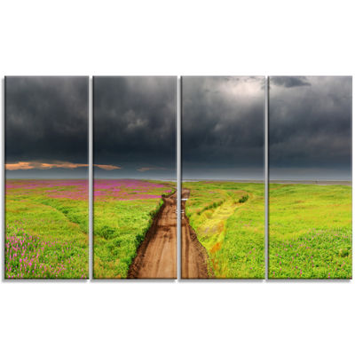 Designart Dirty Road In Blossoming Field LandscapeCanvas Wall Art - 4 Panels