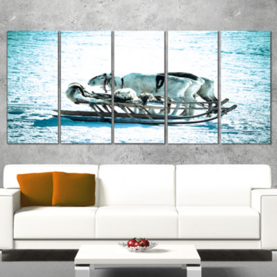 Designart Dogs On Reindeer Sleigh Oversized AnimalWall Art- 4 Panels