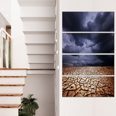 Designart Dramatic Cloudy Sky Over Drought Land Extra LargeLandscape Canvas Art - 4 Panels