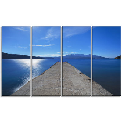 Designart Elba Island Pier And Capanne Mountain Oversized Landscape Wall Art Print - 4 Panels