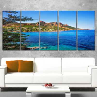 Designart Esterel Rocks Beach Coast In Blue ExtraLarge Seashore Canvas Art - 4 Panels