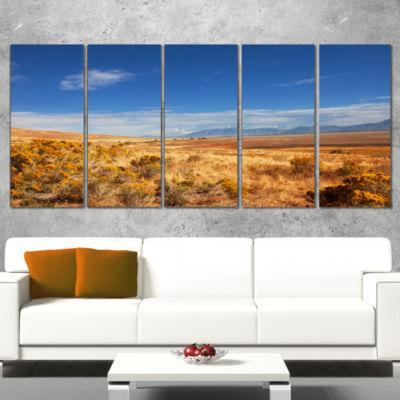 Designart Expansive Prairie Under Blue Sky Landscape WrappedCanvas Art Print - 5 Panels