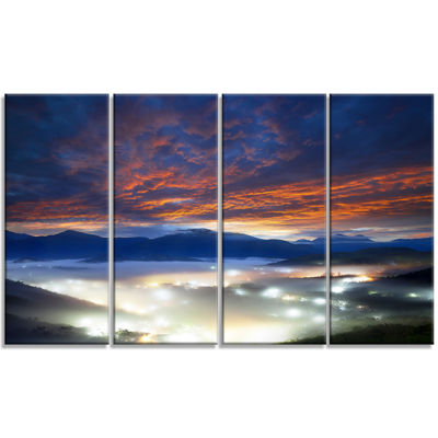 Designart Fiery Clouds And Lit Up Villages Landscape Photo Canvas Art Print - 4 Panels