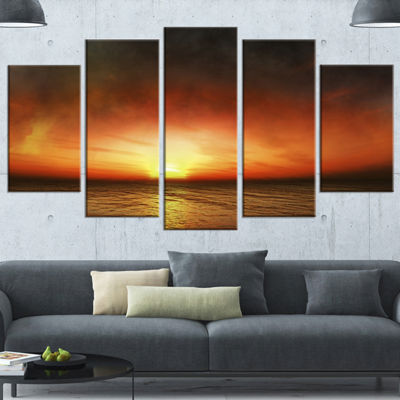 Designart Fiery Sunset Beach Under Cloudy Sky Modern Seashore Wrapped Canvas Art - 5 Panels