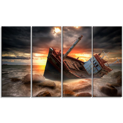 Designart Fishing Boat Beached Landscape Photography CanvasArt Print - 4 Panels