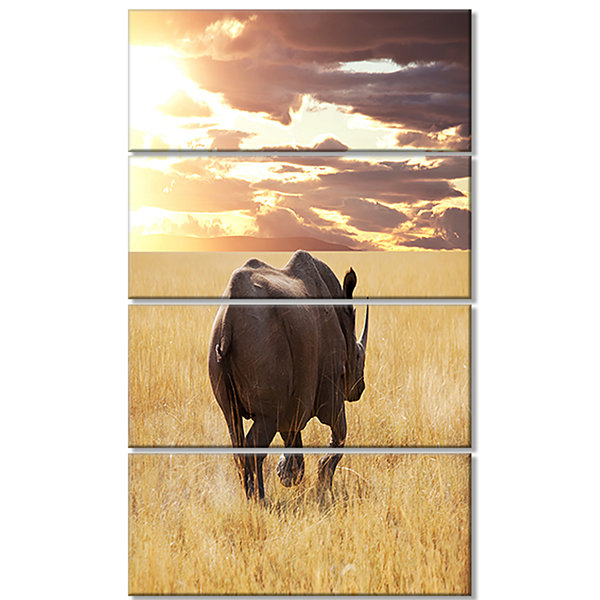 Designart Giant Rhino Under Bright Sky African Wall Art Print - 4 Panels