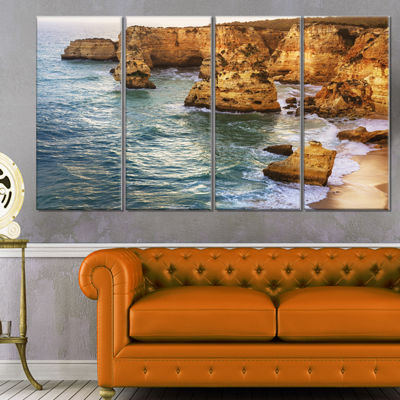 Designart Golden Rocks And Beach At Algarve ExtraLarge Seashore Canvas Art - 4 Panels