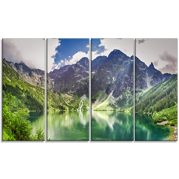 Designart Green Lake In Mountains Panorama Landscape CanvasArt Print - 4 Panels