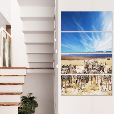 Designart Herd Of Zebras Under Blue Sky African Canvas Art Print - 4 Panels
