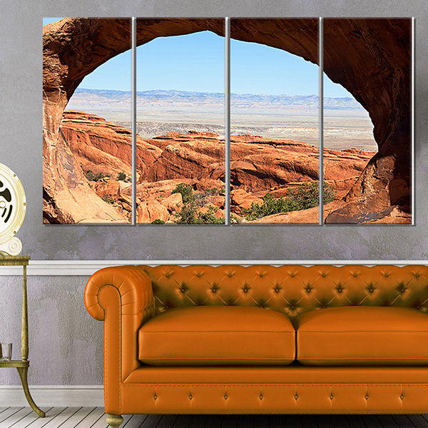 Designart Huge Arch Into Rocky Terrains LandscapeCanvas ArtPrint - 4 Panels