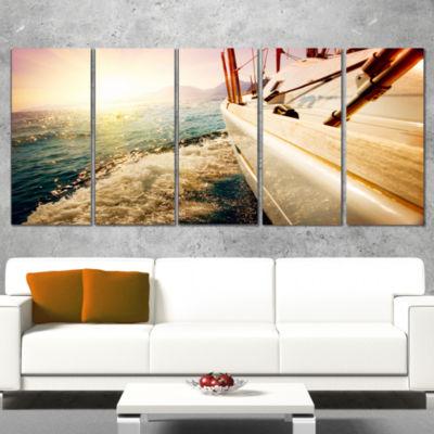 Huge Yacht Sailing Against Sunset Pier Wrapped Canvas Art Print - 5 Panels