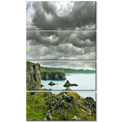 Icelandic Coast Under Dark Clouds Large Seashore Canvas Print - 4 Panels