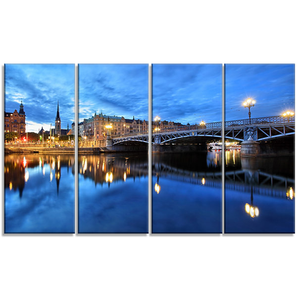 Designart Illuminated Blue Stockholm Cityscape Canvas Print- 4 Panels