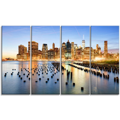 Designart Illuminated New York Skyscrapers Cityscape CanvasPrint - 4 Panels