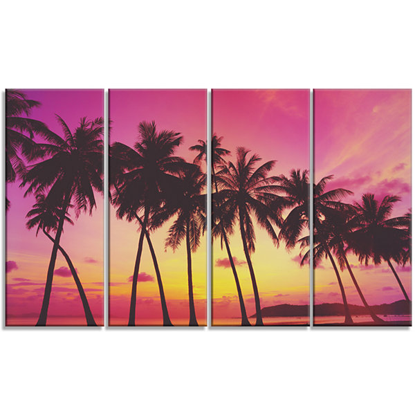 Designart Row of Beautiful Palms Under Magenta SkyExtra Large Wall Art Landscape - 4 Panels
