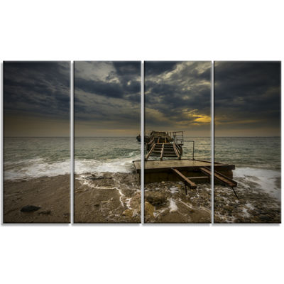 Designart Ruined Wooden Pier For Boats at Sunset Sea BridgeCanvas Art Print - 4 Panels