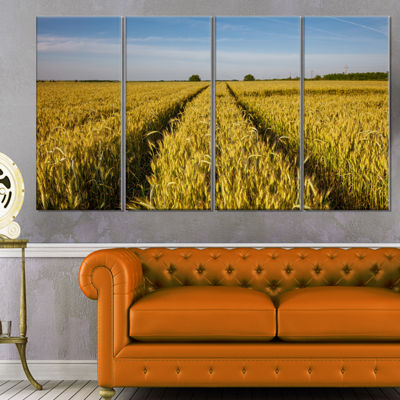 Designart Rural Road Through Wheat Field LandscapeArtwork Canvas - 4 Panels