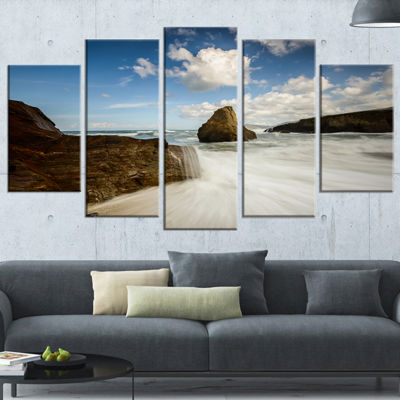 Designart Rushing Waters into Rocky Mountains Seashore PhotoCanvas Print - 5 Panels