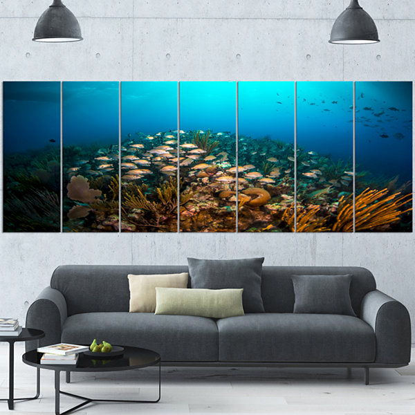 Designart School of Grunts Swimming in Water LargeLandscapeCanvas Art - 7 Panels