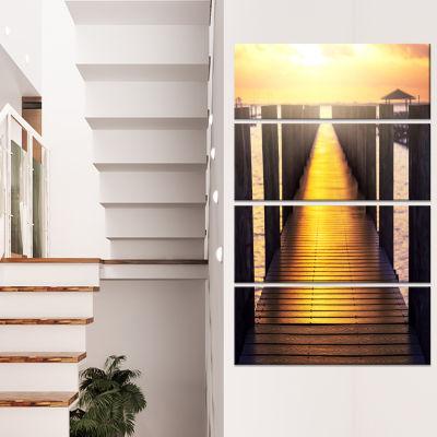 Designart Sea Bridge with Sunset Reflection Seashore CanvasArt Print - 4 Panels