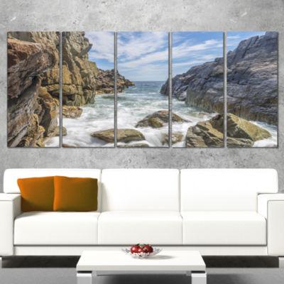 Designart Sea Waves Hitting Rocky Shore Modern Seascape Canvas Artwork - 4 Panels